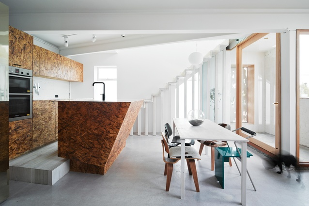 On the lower level of Cubby House, the kitchen is defined by a rise in floor level and changes in surface finishes.
