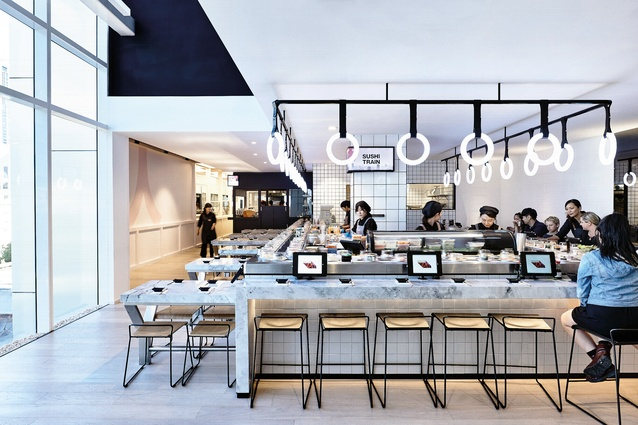 The design of the sushi tran was inspired by subway stations. It features subway tiles and glowing led rings that are reminiscent of train handles.