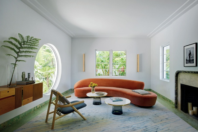 The sitting room uses transparency, eclecticism of materials and colour to hint at the nouveau tropical interior.