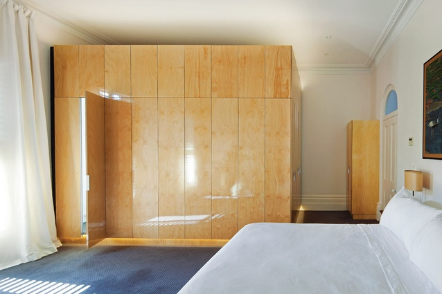 "The ensuite and wardrobe is inserted as a ""pod"" in the main bedroom."