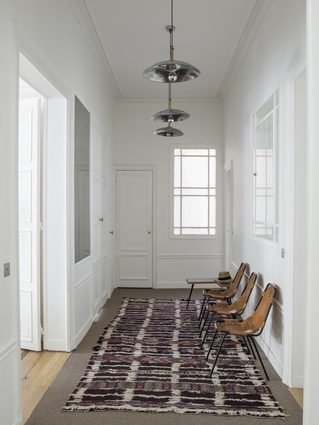 The three hallway chairs are by Charlotte Perriand.
