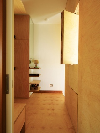 Upstairs, operable plywood panels open the room up to light and breezes, while the glass panes are fixed.