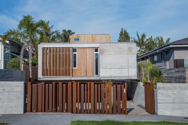 A custom Corten steel 'screen' provides security while affording a level of transparency, allowing the property to engage with the streetscape. The slatted cedar sunscreen echoes the steel providing cohesion between the materials.