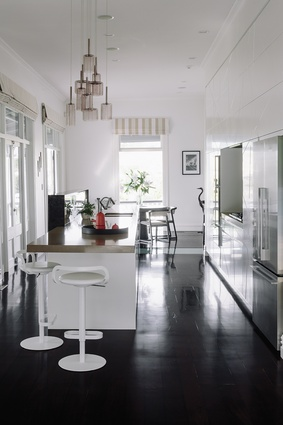The orientation of the kitchen means the eye travels both to the dining area and out of the backyard.