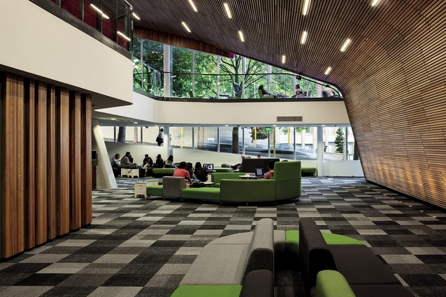 Flexible furniture arranged under a fold of the lecture theatre cloak.