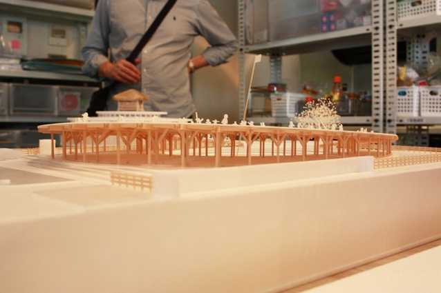 """Model of a second oval kindergarten in Tezuka Architects' studio. Its roof is inclined to the south for solar gain. The """"inclination changes everything,"""" said Tezuka."""