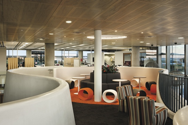 View towards the landing, an informal meeting area that looks out over the double-space void above the café. Plenty of provision has been made for informal meetings, with high-backed sofas being one device utilised.