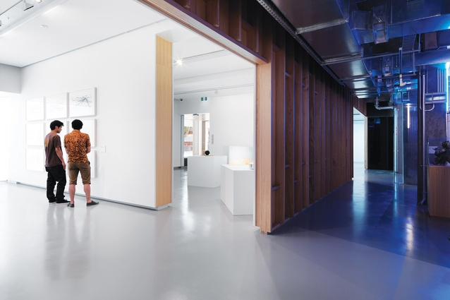 A geometric counterpoint between the stripped back existing building and an inserted central corridor.