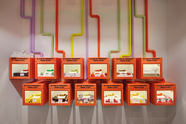 Macaroon display boxes reference <em>Charlie's Chocolate Factory</em>.