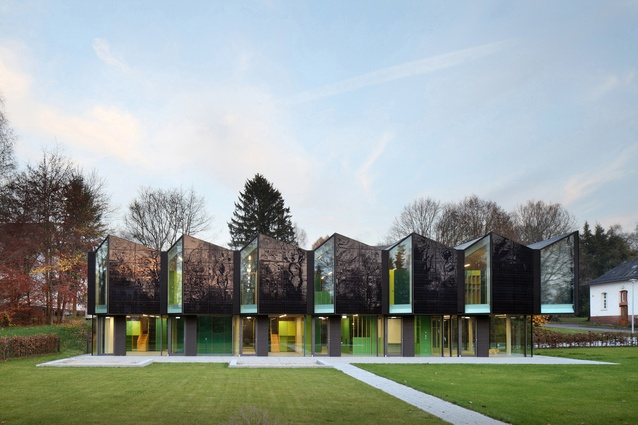 Nursery +E in Marburg, Germany by Opus Architekten. Solar panels are integrated in the folding facade, and are perfectly aligned to generate as much energy as possible.