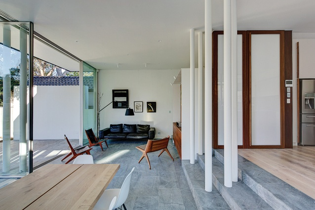 The rear spaces have an exaggerated informality, the timber poles replaced here by clusters of white metal poles.