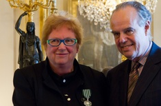 Louise Cox has been presented with the insignia of Knight in the Order of Arts and Letters