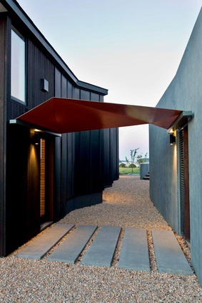 The house has been designed as separate pavilions to accommodate a growing family and guests.