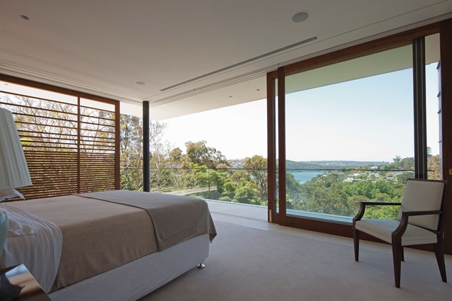 Large sliding doors with recycled blackbutt frames give the impression of a bedroom in the treetops.