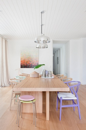 Pops of pastel sit comfortably alongside pine floors and furniture.