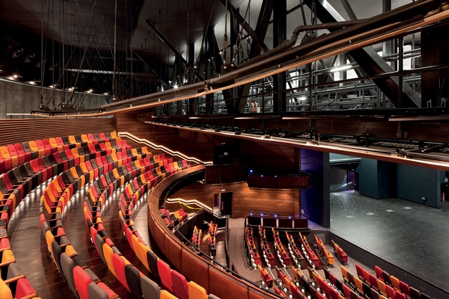 Multi-coloured seats create the appearance of a full theatre and are arranged in an arc, so theatre-goers can gain a sense of the audience's shared presence.
