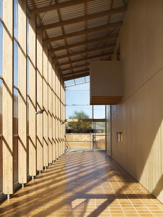 An enclosed two-storey verandah and learning space runs the length of the western facade.
