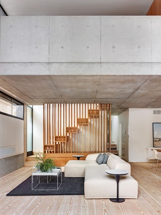 The Glebe House living area features a staircase designed as a series of floating boxes.
