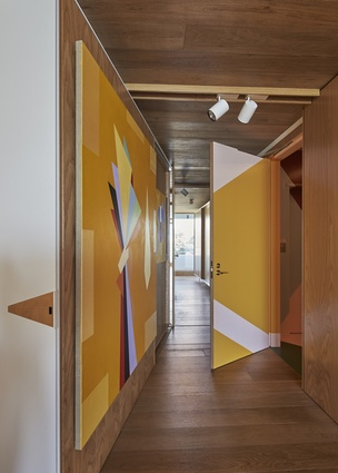 Guests are welcomed by an Esther Stewart mural in a geometric pattern that reflects her distinctive colour palette.
