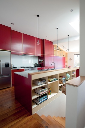 Atelierworkshop has used coloured plywood – which has colour actually embedded in the fibre of the wood – for the bold red kitchen.