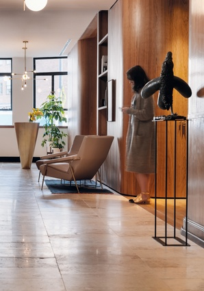 The waiting area gives visitors a sense of what paramount offers – an elegant mix of domesticity and hospitality in an office setting. Sculpture: <i>Charles</i> (2011) by Thomas Campbell.