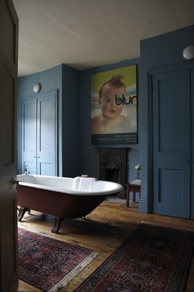 Walls painted in Farrow and Ball's Stone Blue.