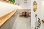 The Fibonacci Stone terrazzo tiles selected for Waffee cafe reinforce its earthy colour palette