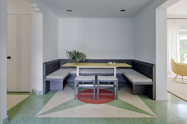 A dining nook with original colourful terrazzo flooring.