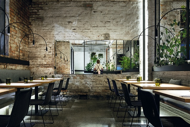 Soft lighting throws enough light to highlight the brickwork's texture.