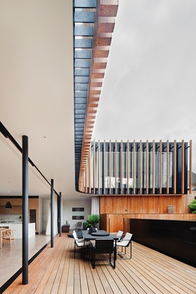 Signature detailing of the door and window tracks, developed with the manufacturer, ensures that boundaries between inside and outside are blurred at Kooyong House.