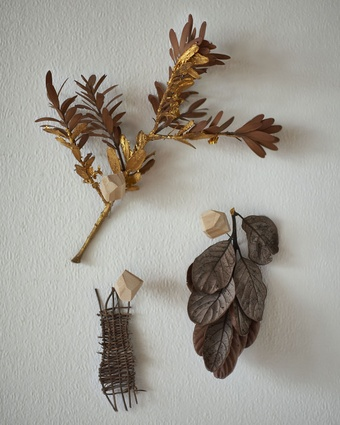 """Gold kauri branch: """"This is a branch from a tree in our garden,"""" says Leanne. """"And an artwork I created out of concern for these native trees which are in danger of extinction."""""""