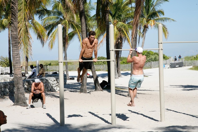 Locals work out, while working on their tans.