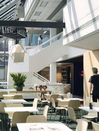 The staff canteen sits on the edge of the impressive void, allowing sight lines throughout the building.