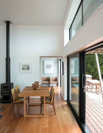 The open-plan living area opens up to decking along the north side of the house.