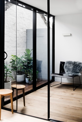 A terrace off the bedroom lets in ample daylight and facilitates a visual connection with the original brick structure.