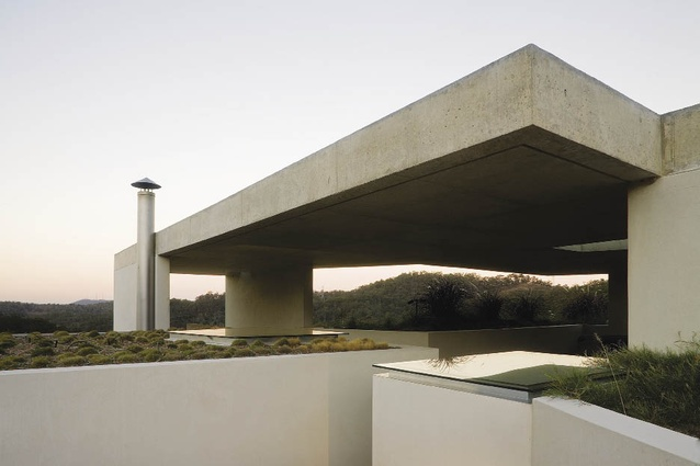 B House, 2007, Brisbane, Qld: Embedded into the side of the hill, the B House uses the thermal mass of concrete to further shield from extreme temperatures.