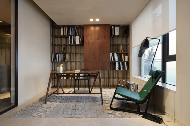 An office area includes a desk by Porada and an armchair by Jean Prouvé.