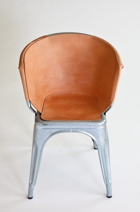 Wilson's fitted leather slipcover for original Tolix chairs.