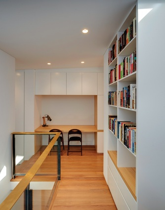 A nook between the upstairs bedrooms, complete with lovingly crafted joinery, offers a quiet spot for study.