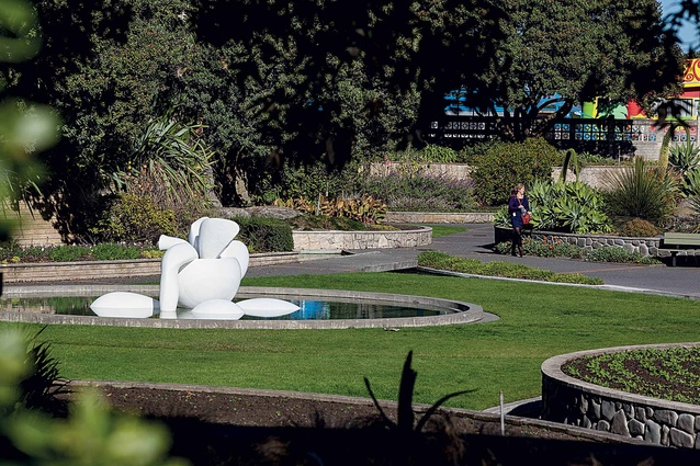 A large sculpture installed in a public garden.