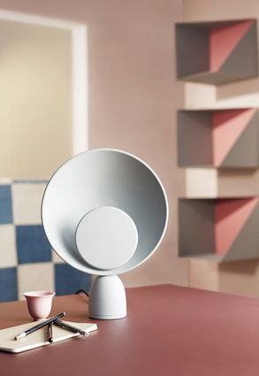 The Blooper table lamp by Please Wait to be Seated features an LED light hidden between two discs.