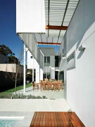 The house is clad in composite, fire-rated panel with sheet steel exterior and an acid-free recyclable core.