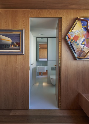 The extensive use of timber throughout the apartment is offset by coloured bathrooms.