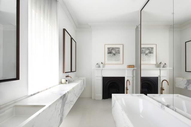 Honed marble, waxed brass taps and mirror surrounds acknowledge the historic significance of the home.