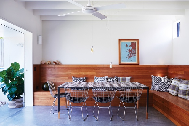 Sustainably sourced Tasmanian blackwood wraps around the dining area to create an inviting built-in bench seat.