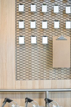 The community noticeboard was custom designed and is made from mesh, bulldog clips and clipboards.
