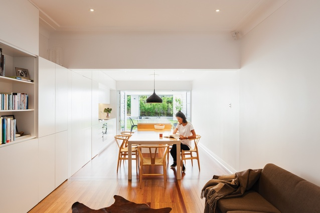 At Breeze Block House, the kitchen's island bench has two parts – a lower table and a higher conjoined benchtop.