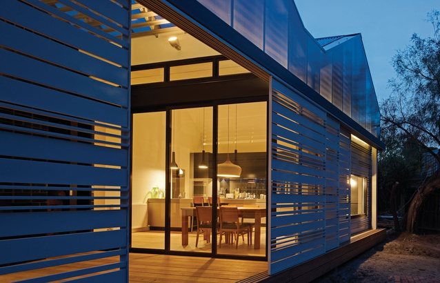 The timber screens give the rear elevation a sculptural play of light.