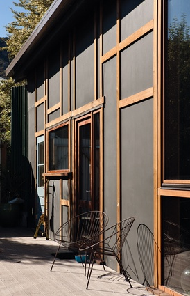 The previous building had been brick. The new building is clad in an structurally insulated panel system.