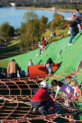 The playspace includes climbing nets and tunnels.